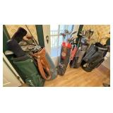 Large lot of golf clubs
