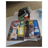 Tarp straps, zip ties, propane tank, Staples, and