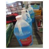 Four jugs of windshield washer fluid