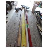 Two brooms, cane, yardstick