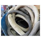 Assortment of hoses and a tub