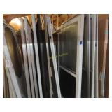 Large assortment of screen doors, 32 by 78, 32 by