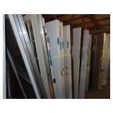 Large assortment of doors including front doors,