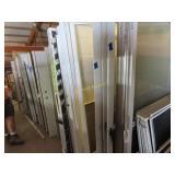 Large assortment of front doors, back doors,