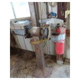 Electric Delta bench grinder mounted on metal