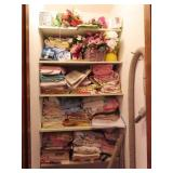 Bed linens, bath linen and items in closet
