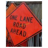 Two 1 lane and 1 flagger sign