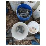 Approximately 17 buckets of guardrail bolts
