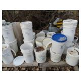 Several buckets of used guardrail Hardware