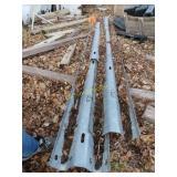 four pieces of guardrail various lengths