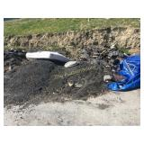 Piled asphalt in yard
