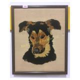 Framed needlepoint of a dog