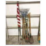 Assorted yard tools and an American Flag