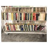 Two Shelves of Assorted Paperback Books