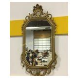 Nicely framed wall mirror