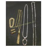 Several necklaces, plus earrings, marked Monet