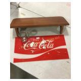 Coca-Cola sign, mug, display shelf
