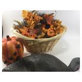 Wicker laundry basket with pumpkin