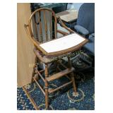 Old wooden high chair with tray