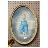 Framed hand tinted photo of young boy