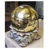 Gold color gazing ball in stand