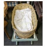 Woven wooden bassinet and stand