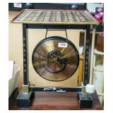Iron gong in wooden stand