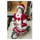 Christmas dolly riding bicycle