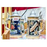 4 German steins with pewter (?) lids