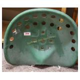 Iron tractor seat painted green