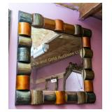 Beveled wall mirror w/ modernistic frame