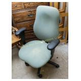 Padded roll around office chair