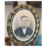 Antique photograph in vintage oval frame