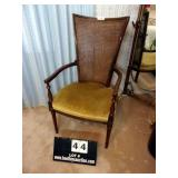 UPHOLSTERED ARM CHAIR W/ CANE BACK