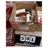BOX: POWER STRIP, CASSETTE TAPES, BOOKS, BLOOD