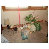 Decor items, lamp, fake plants, tea set, art, and