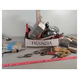 Assorted tools, trowels, wood burner heat lamp,