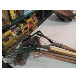 Assorted garden tools, rakes, hos and more