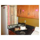 Laundry room decor - rug beater, clothes pins +