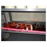 6 smaller canister crocks w/ lids