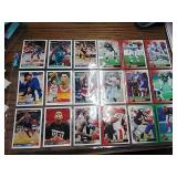 Lot of 9 sports cards.  Basketball,  football