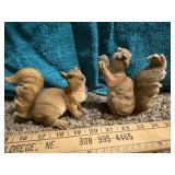2 squirrel figurines