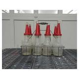 8 Huffman oil bottles w/ spouts and wire holder