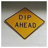 SS metal dip ahead road sign