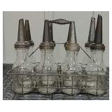 8 glass oil bottles w/ spouts & wire case
