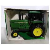 Die-cast John Deere row crop toy tractor