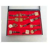 12 watch fobs in display case