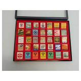 35 advertising matchbooks in display case