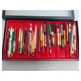 Advertising pens and pencils in display case
