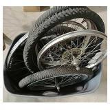Tote full of bicycle wheels